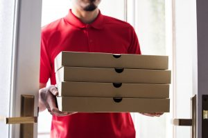 Man delivery pizza to customer