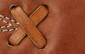 Leather baseball glove macro background
