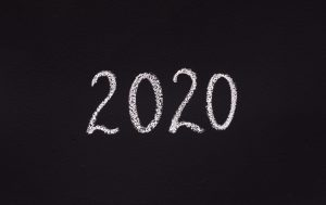 White chalk 2020 concept writing on black board