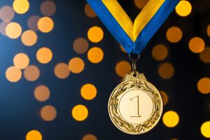 Gold champion or winners medallion on a ribbon