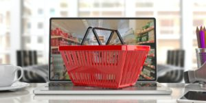 Supermarket online shopping. Shopping basket on a laptop.3d illustration