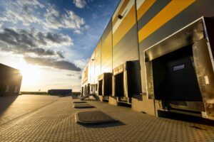 Cargo loading dock doors of big warehouse building, outdoor
