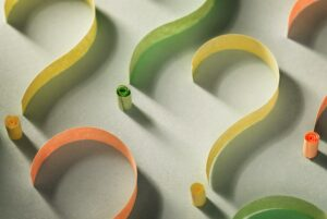Colorful question marks of curled paper tape