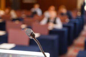 Microphone over conference hall background